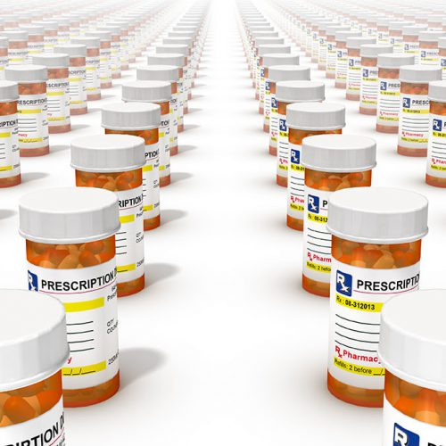 Prescription pill bottles lined up