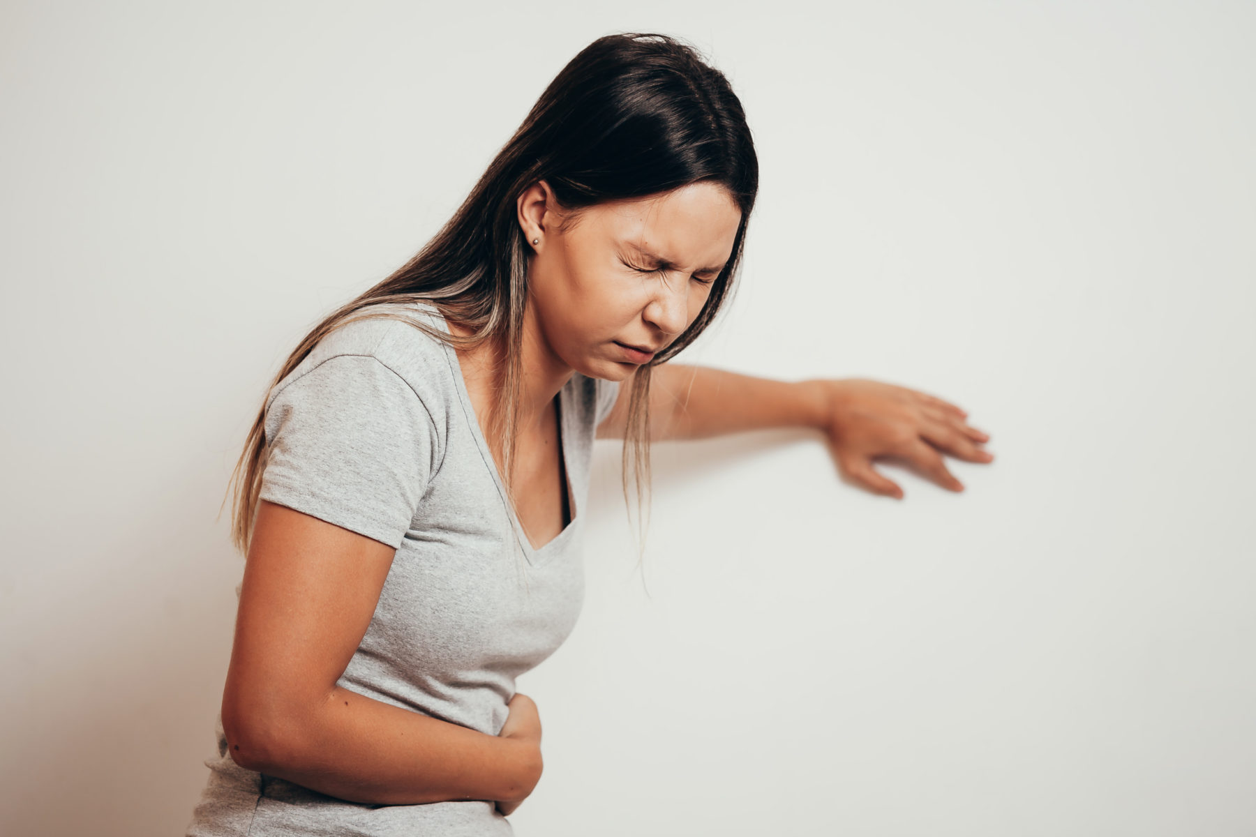 woman experiencing Zantac® side effects